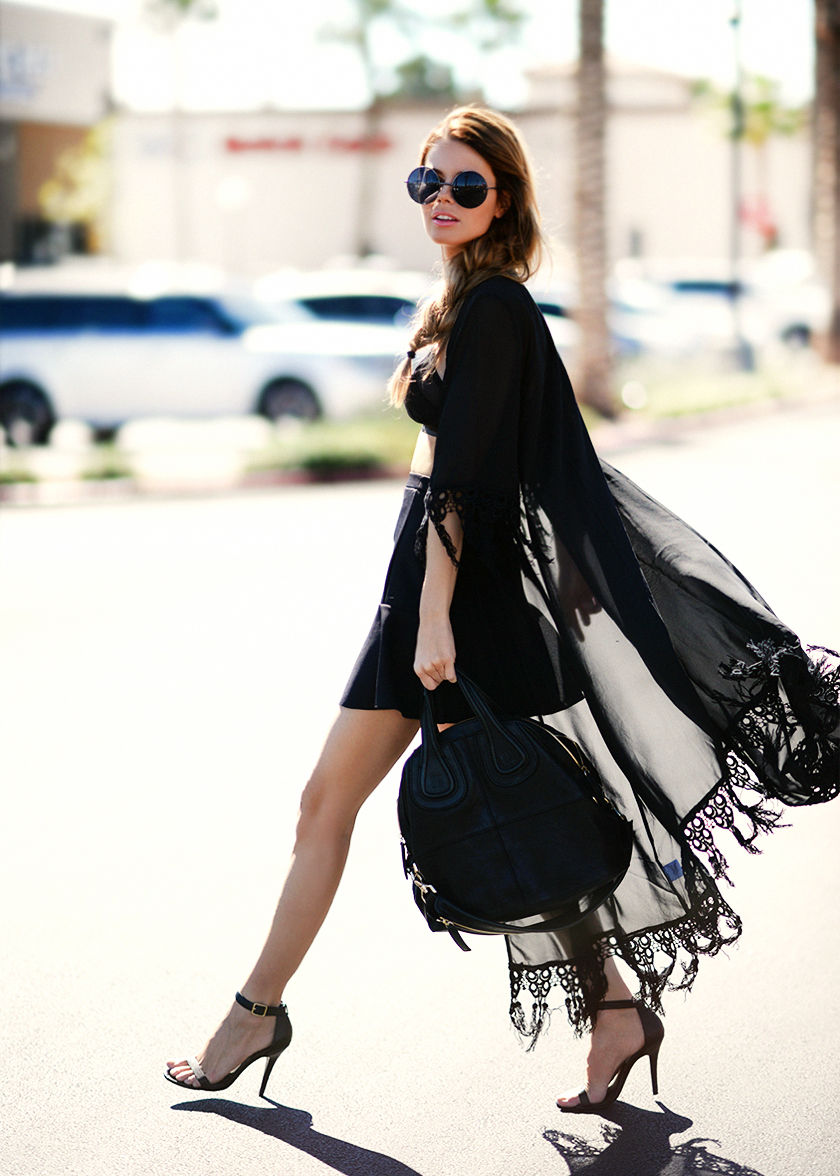 Annette Haga is wearing a all black, lace trimmed kimono from For Love & Lemons, bralet from Finders Keepers, skirt from Topshop, bag from Givenchy and the shoes are from Steve Madden