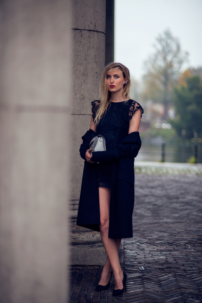 Rebecca Laurey is wearing a little black lace dress from NLY, coat from Designer's Remix, shoes from All Saints and the bag is from Alexander Wang