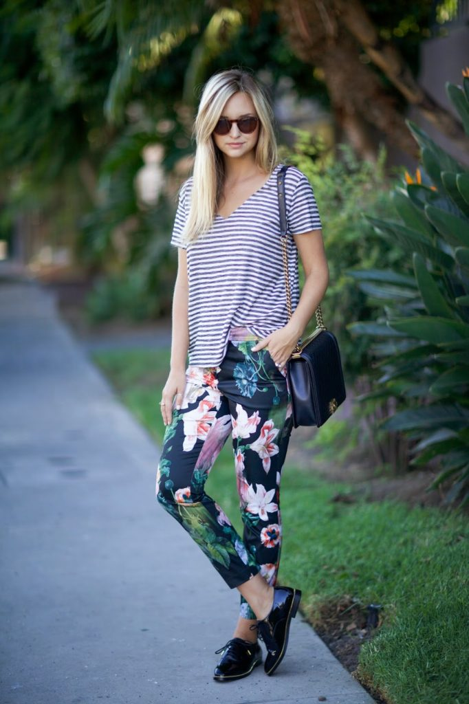Liz Cherkasova is wearing a floral print pants from Ted Baker, striped top  from Project Social T, shoes from H&M and the bag is from Chanel