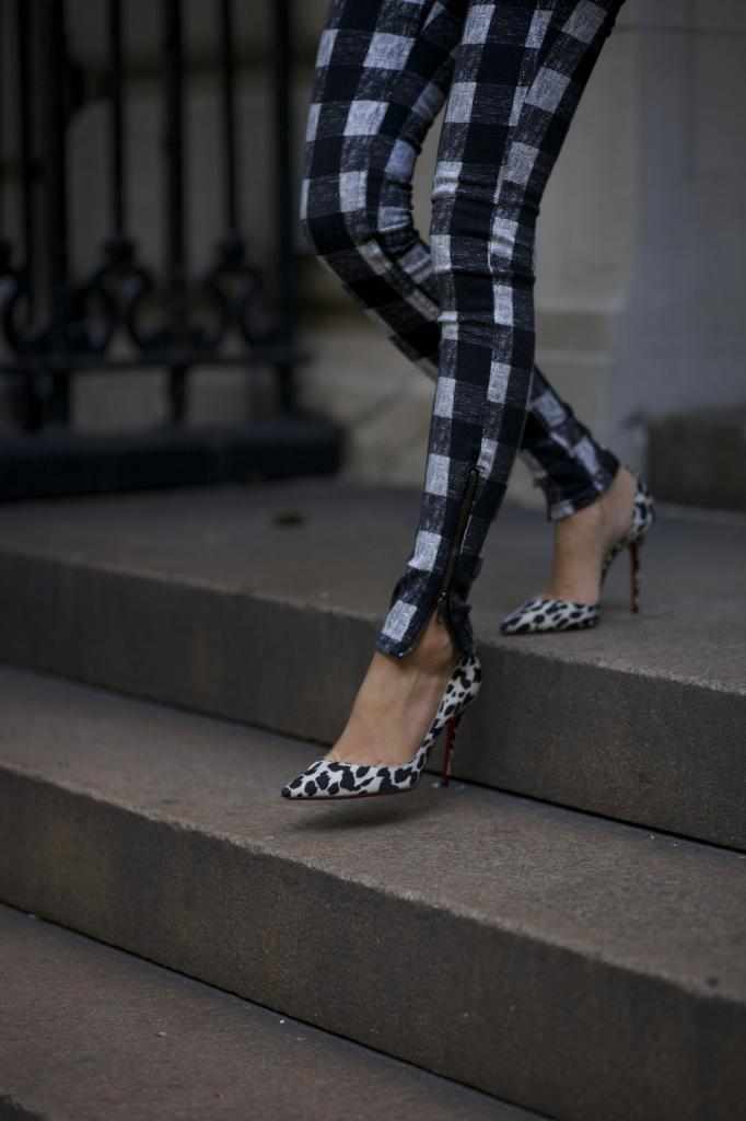 Arielle Nachami is wearing check jeans from Rag & Bone and shoes from Christian Louboutin