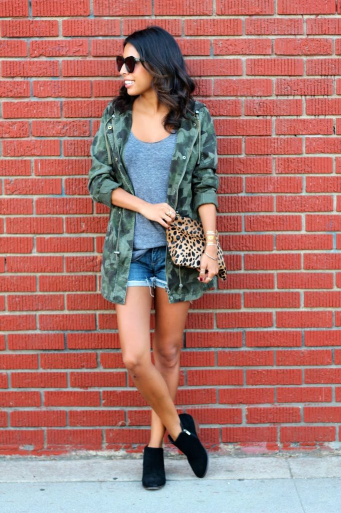 Ashley Torres is wearing a camouflage anorak from Target, denim shorts from Joe's Jeans, sunglasses from Karen Walker and the leopard print clutch is from DSW