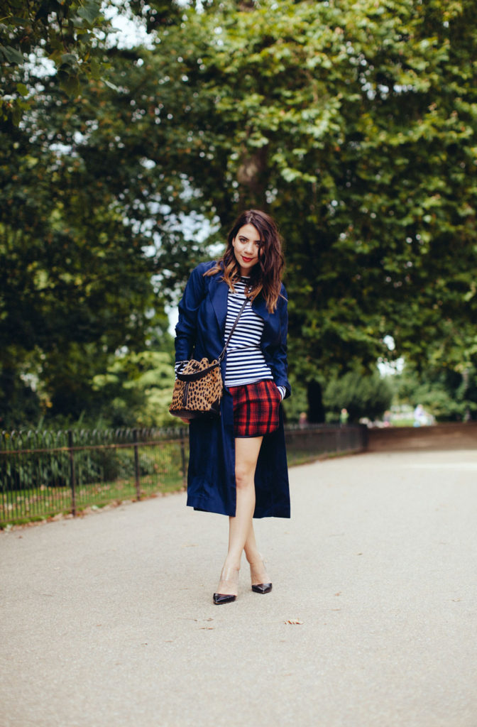 Reem Kanj is wearing a coat from ASOS, shoes from Gianvito Rossi, bag from Elizabeth and James and the striped top and plaid shorts are from Harvey Faircloth