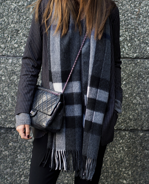 Mixed Print 2014: Funda Christophersen is wearing a pinstriped blazer from Second Female, grey sweater from Moliin, plaid scarf from Gestuz and the bag is from Chanel