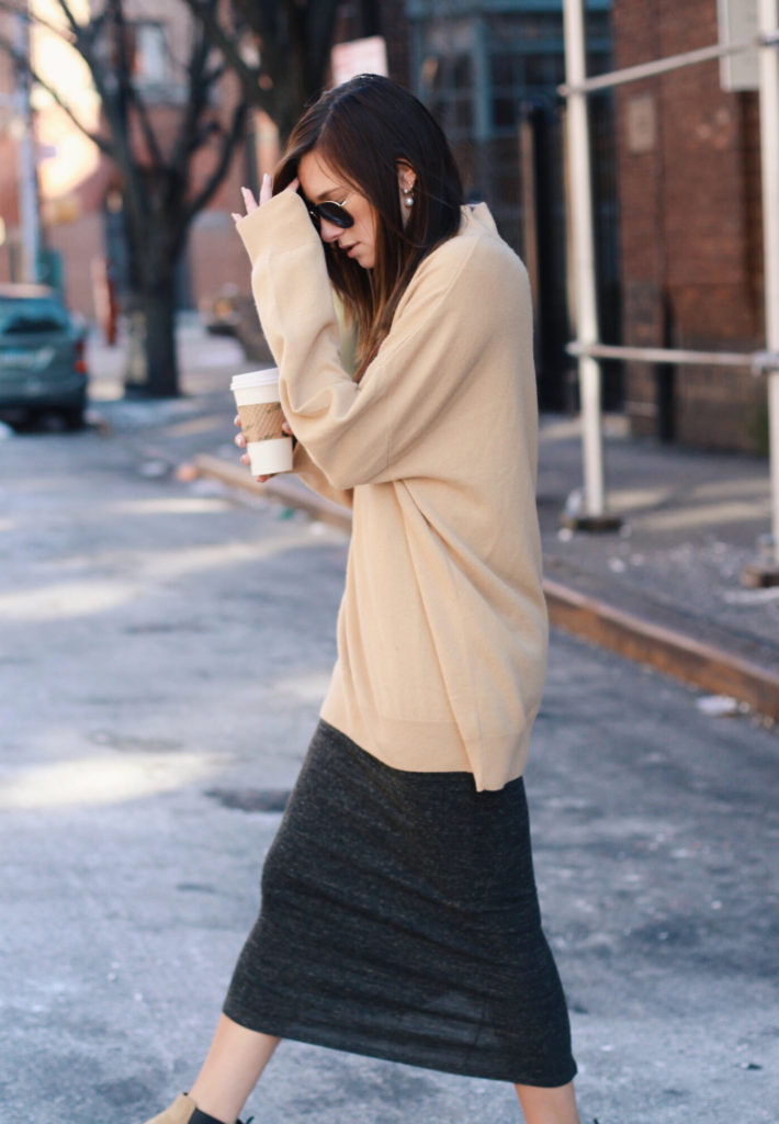 Danielle Bernstein is wearing an oversized tan sweater from & Other Stories