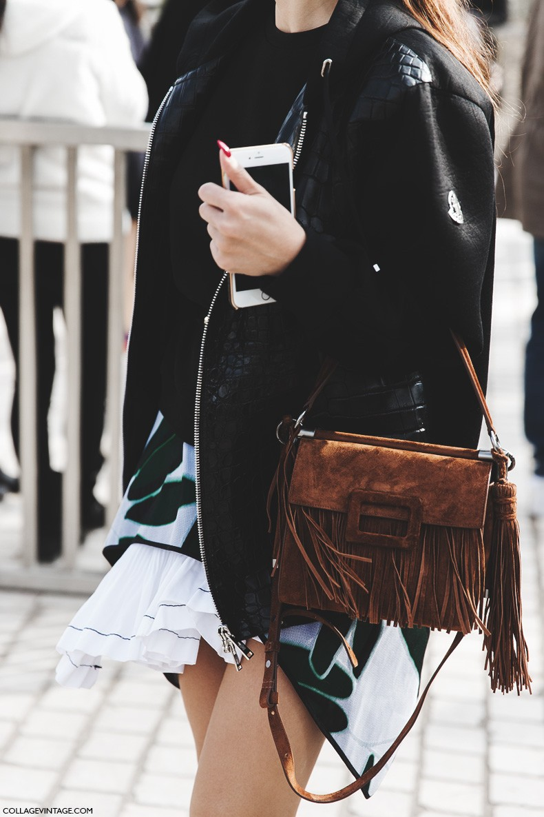 Fringe Fashion Trend 2015: Sara Escudero is wearing a brown suede fringed clutch bag