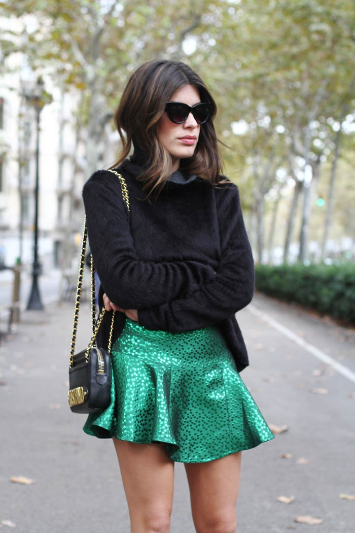Aida Domenech is wearing a black faux fur Sweater from Zara and the green skirt is from Minuet
