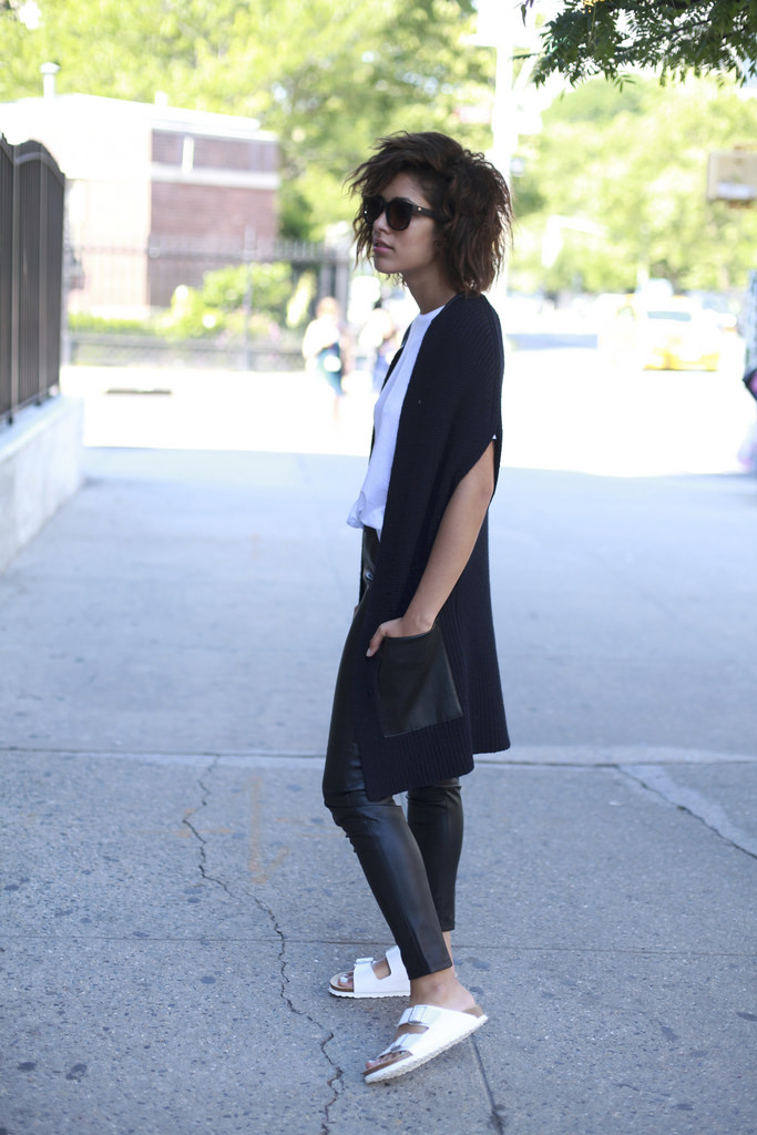 Christina Caradona is wearing a shirt from J Brand, sweater vest and leggings, shoes and bag from Ann Taylor and sunglasses from Spy