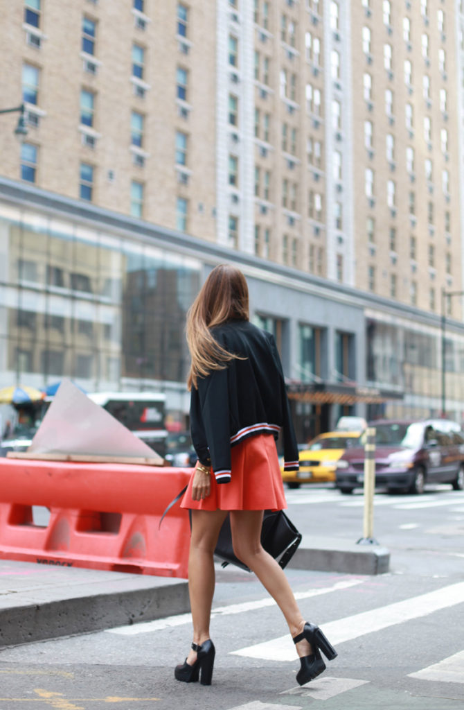 Silvia C. is wearing a pleated skirt and bomber jacket from Vila, shoes from Zara and the bag is from Celine