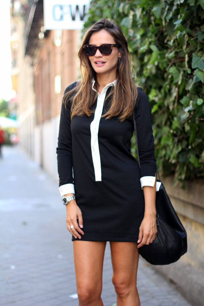 Silvia Zamora is wearing a black and white dress from Zara , backpack from Rita Rembs and sunglasses from Celine