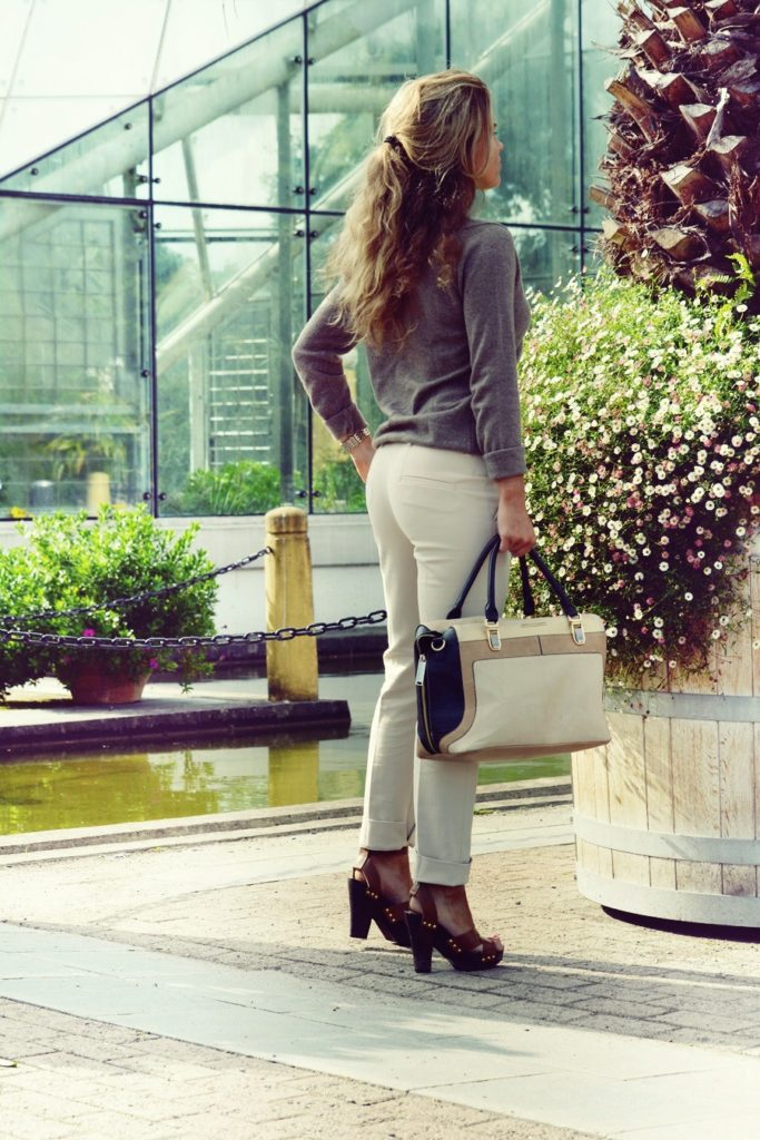 Molly Rustas is wearing trousers from Zara, top from J Lindeberg and the bag is from River Island