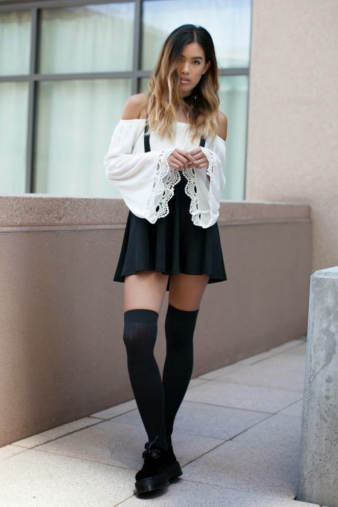 Jill Wallace is wearing a suspender skirt from Gypsy Warrior Holly platform boots from Dr. Martens