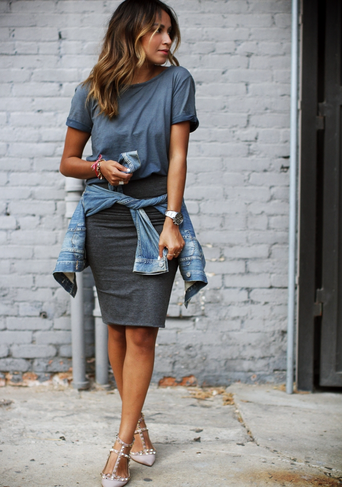 Julie Sarinana is wearing a grey mini skirt from Express, denim jacket from Aritzia and shoes from Valentino