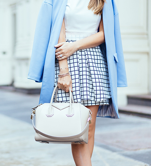 Jenny Bernheim is wearing a check skirt from Cameo, top and pale blue jacket from Elliatt and a the tote is from Givenchy