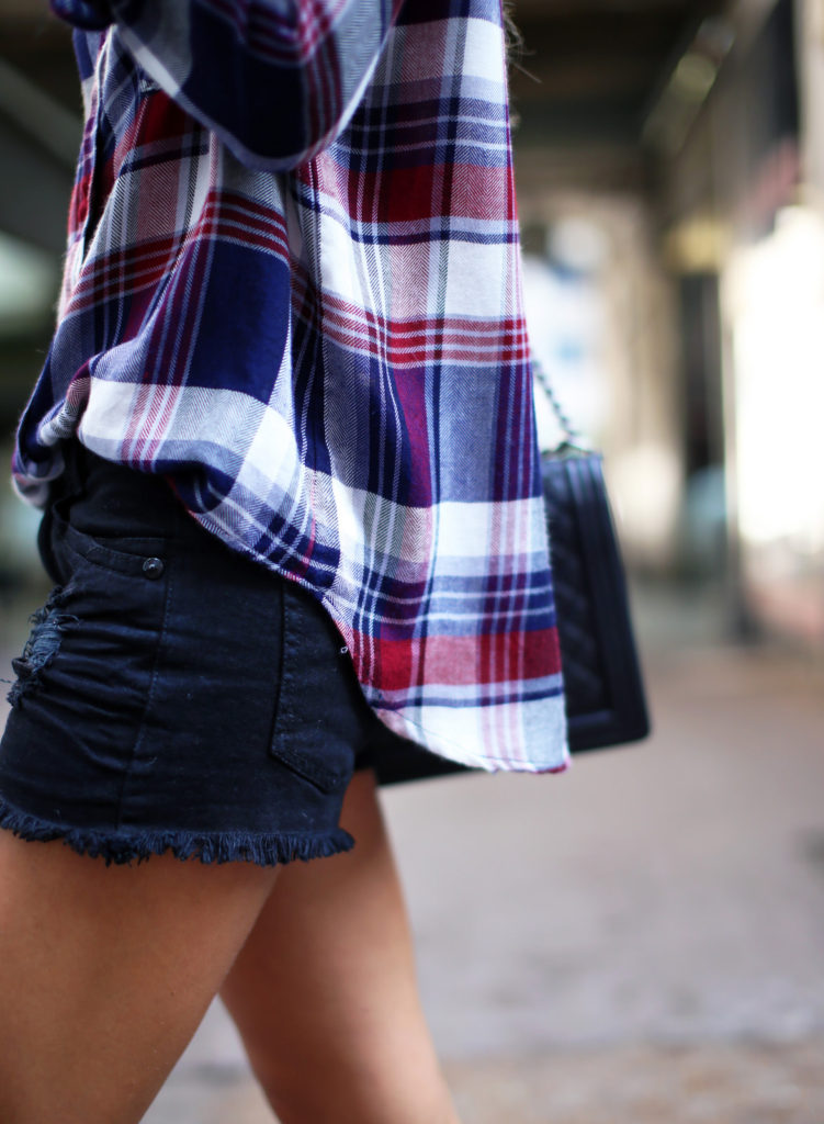 Mary Seng is wearing a plaid shirt from Free People and shorts from Mason & Belle