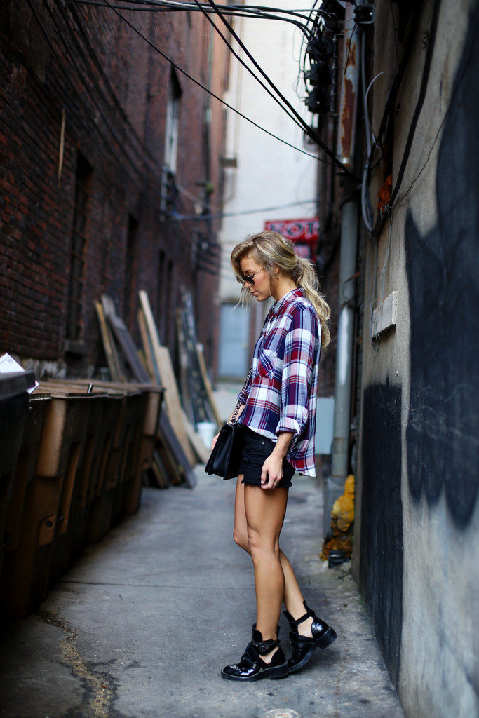 Mary Seng is wearing a plaid shirt from Free People, shorts from Mason & Belle, bag from Chanel and boots from Balenciaga
