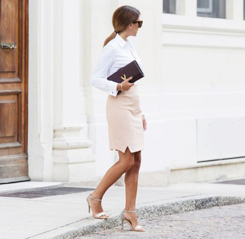 Nicoletta Reggio is wearing a white skirt and pale pink skirt both from M. Bottiglieri, shoes from French Connection, clutch from Saint Laurent and the sunglasses are from Céline
