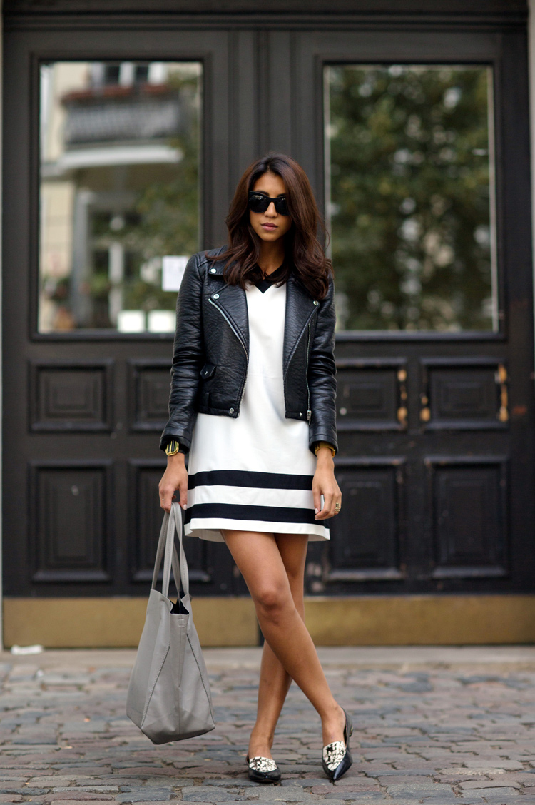 Kayla Seah is wearing all black and white, dress from The Fifth, leather jacket and bag from Zara and shoes from Rachel Zoe