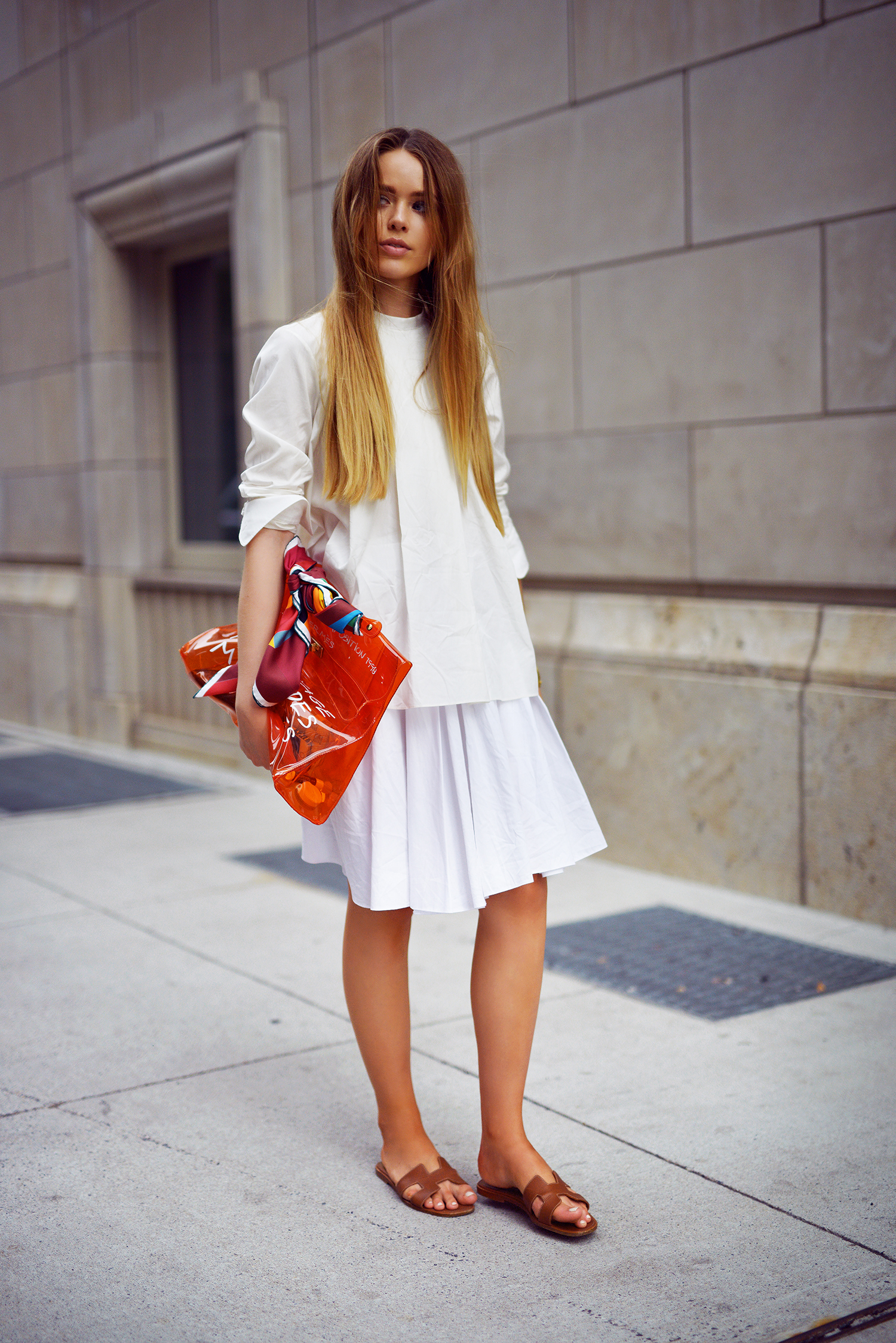 Kristina Bazan is wearing a white top, bag and shoes from Hermès, white skirt from Tara Jarmon