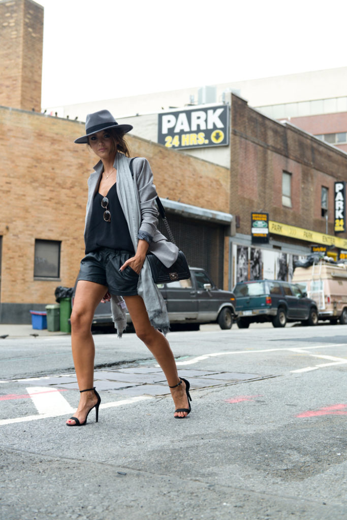 Alexandra Pereira is wearing a hat from H&M, blazer from Lacoste, shorts from Romwe, sandals from schutz, top from Mango and the bag is from Chanel