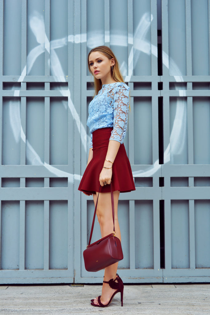 Kristina Bazan is wearing a pale blue lace top from Zara, skirt from BCBG Maxazria and the shoes are from Oscar Tiye