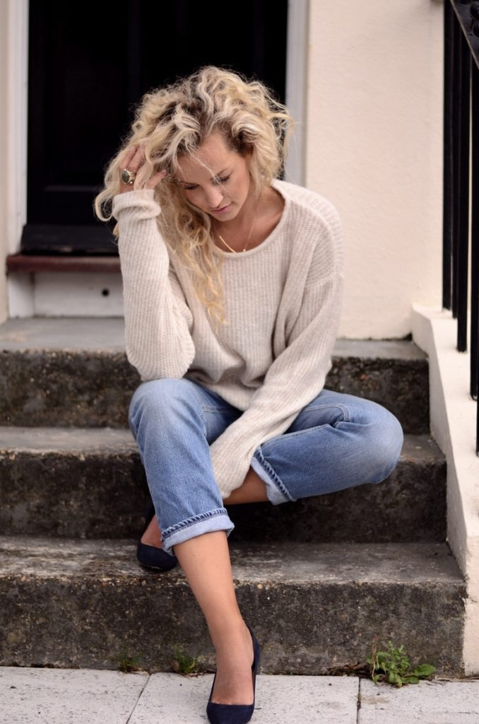 Anouk Yve is wearing a knit top from Sandwich, jeans from Acne and shoes from Whistles