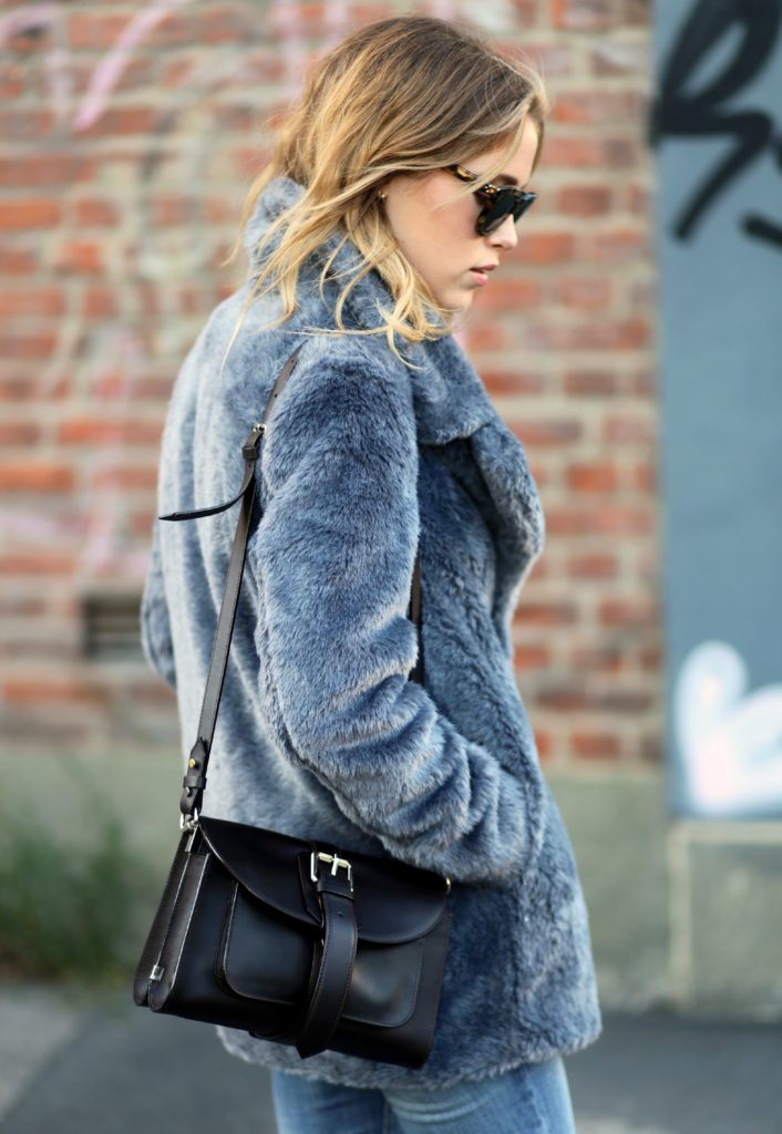 Annabel Rosendahl is wearing a fake fur coat from Sand Copenhagen, jeans from Current Elliott and the bag is from Proenza Schouler
