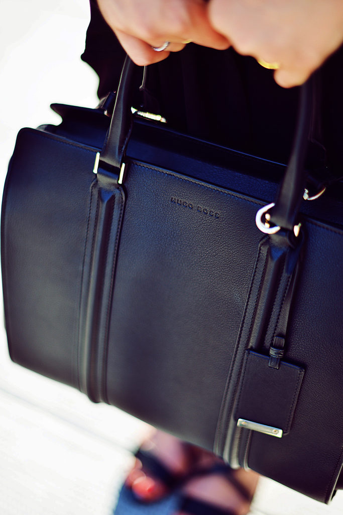 Kristina Bazan's black bag is from Hugo Boss