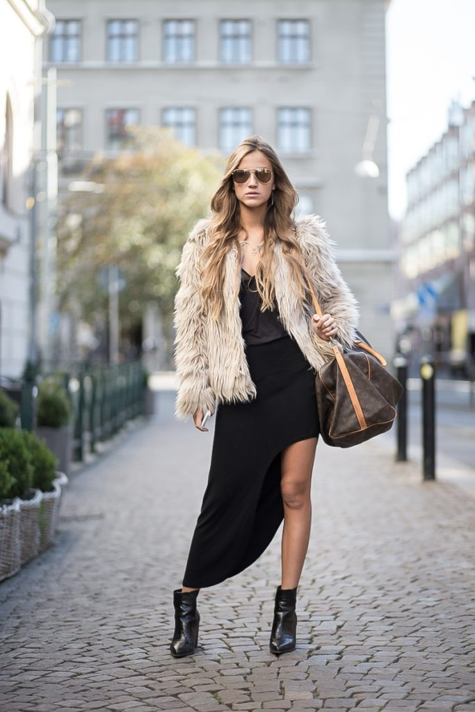 Sandra Willer is wearing a black skirt and boots, faux fur jacket from Nelly