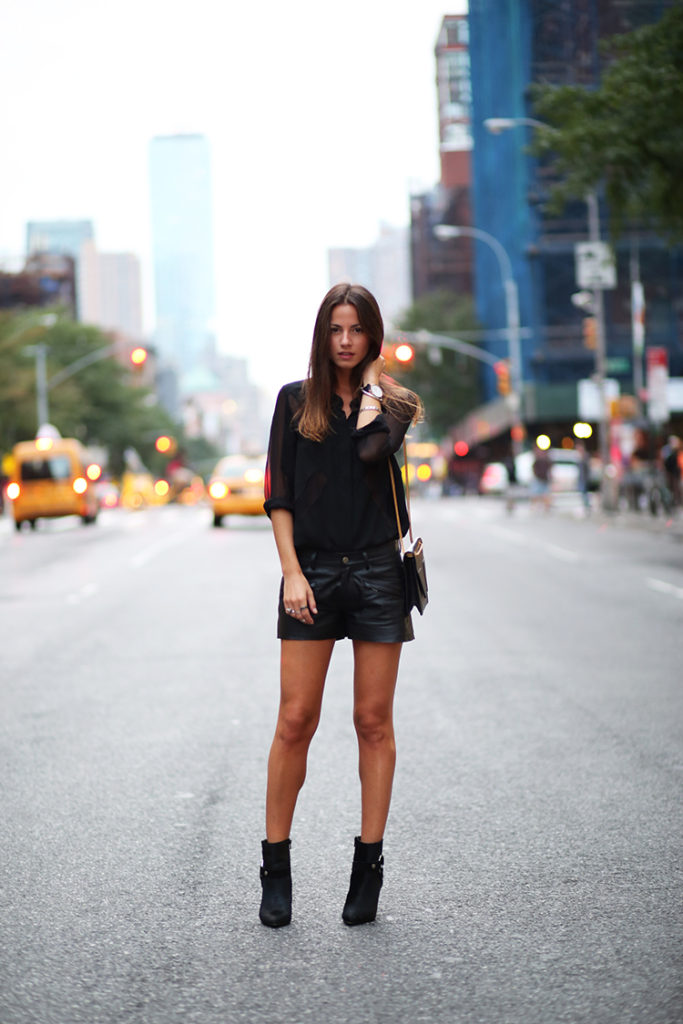 Zina Charkoplia is wearing all blackm, shirt from Iro, leather shorts and boots from Gestuz and a bag from Saint Laurent