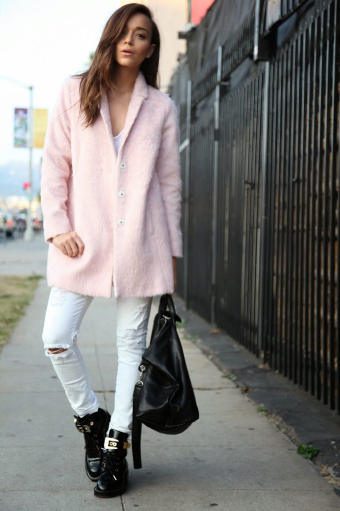 Ashley Madekwe is wearing a pink coat from Topshop, jeans from Paige Denim, bag from Longchamp and the boots are from Balenciaga