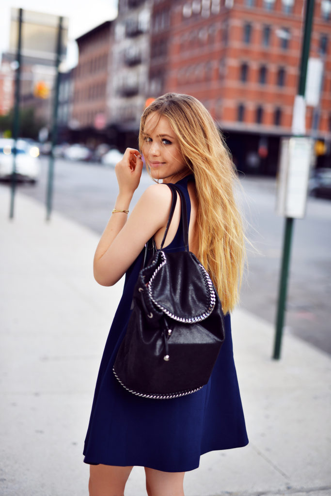 Kristina Bazan is wearing a blue dress from Finders Keepers, slip-ons from Chanel and the bag is from Stella McCartney