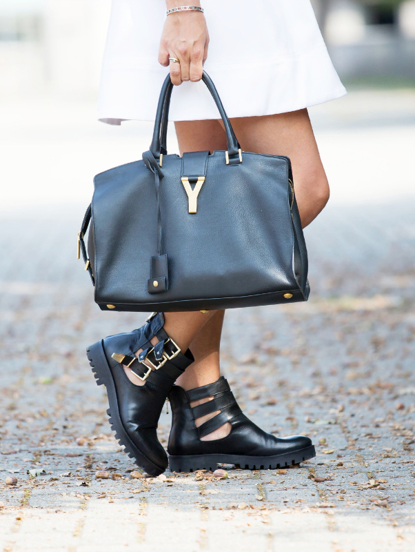 Nicoletta Reggio is wearing a white dress from Gianluca Capannolo, shoes from Corso Roma and the bag is from Saint Laurent