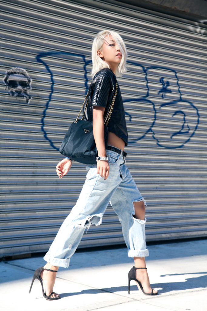 Vanessa Hong is wearing a leather top from Azede Jean-Pierre, boyfriend jeans from No Brand, shoes from Stuart Weitzman and a vintage bag from Prada