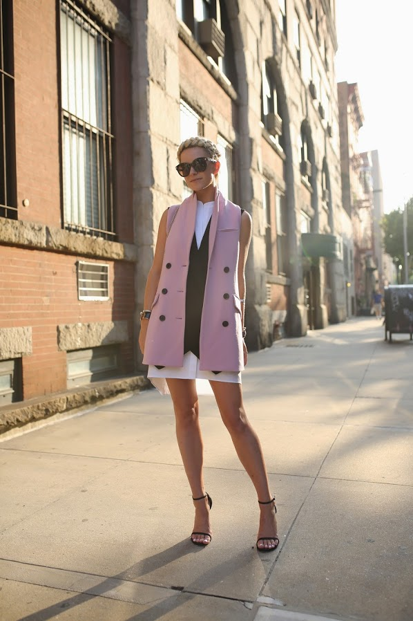 Blair Eadie is wearing a pink sleeveless vest from Marissa Webb, shirt dress from BCBG, shoes from Stuart Weitzman and the bag is from Valentino
