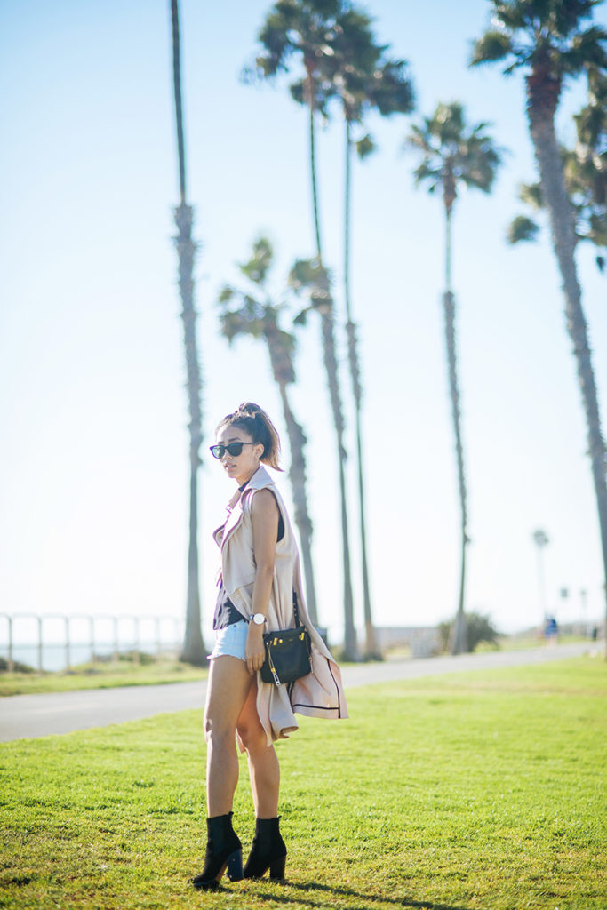Jenny Ong is wearing a a vest from Three Floor, top from A.L.C, shorts from Current/Elliott bag from Botkier, and boots from Coach