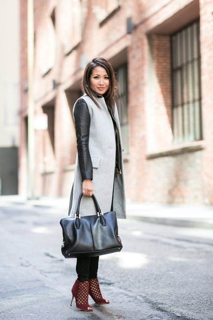 Wendy Nguyen is wearing a sleeveless grey vest from Intermix, jacket from J Brand, trousers from Banana Republic, bag from Tod's and the shoes are from Jimmy Choo