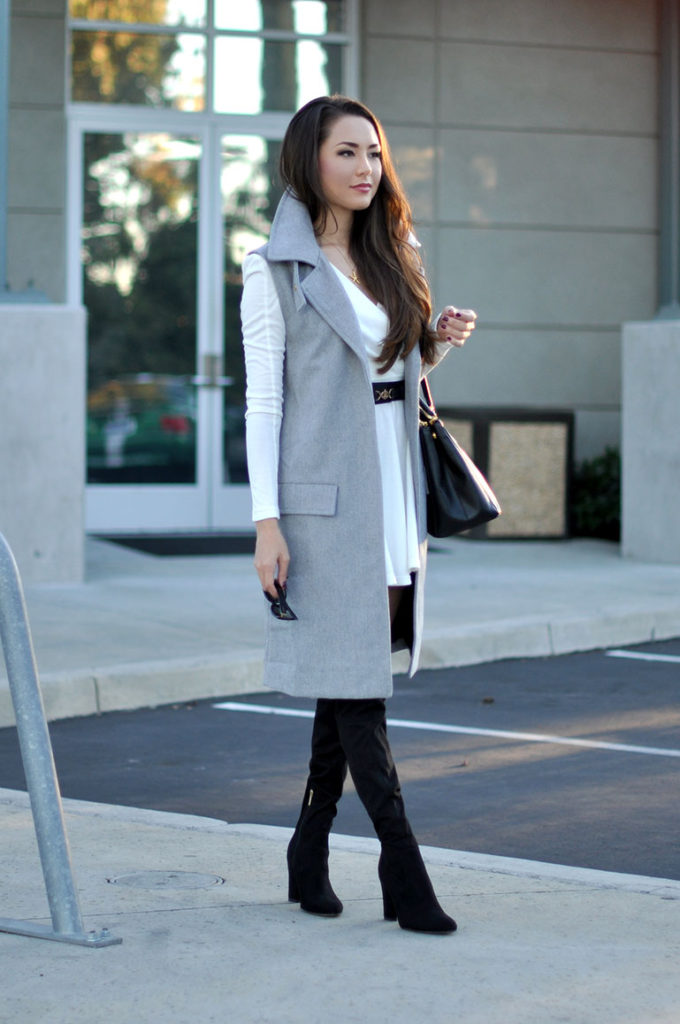 Jessica R. is wearing a sleeveless jacket from Joa
