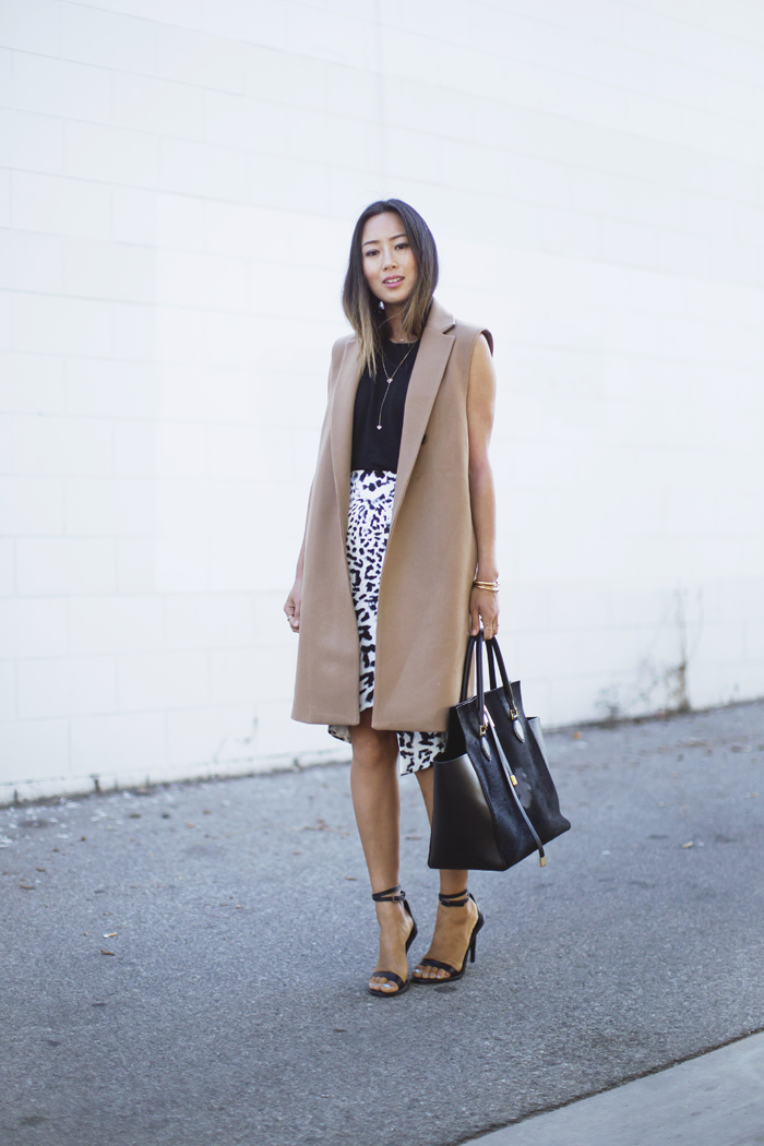 Aimee Song is wearing a Sleeveless Camel Coat from Mango