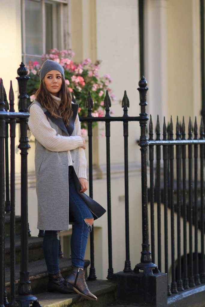 Sleeveless Coat Trend: Tamara Kalinic is wearing a grey sleeveless coat from Gestuz