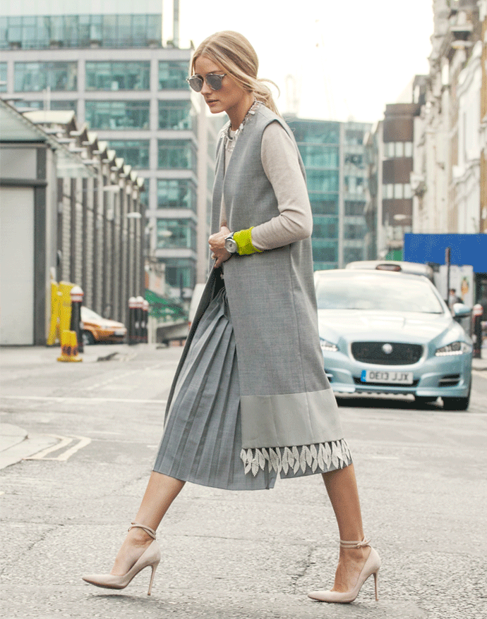 Olivia Palermo is wearing grey sleeveless vest from Nom De Mode, pleated culotte shorts from Tibi, sweater from Chinti and Parker and shoes from Gianvito Rossi