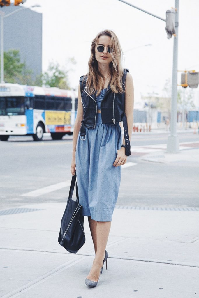 Sonya Esman is wearing a vintage sleeveless leather jacket, dress from Jill Stuart, shoes from Manolo Blahnik, bag from Celine and sunglasses from RayBan