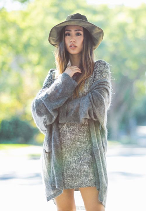 Jenny Ong is wearing a grey cardigan from H&M and a made to measure dress from Piol