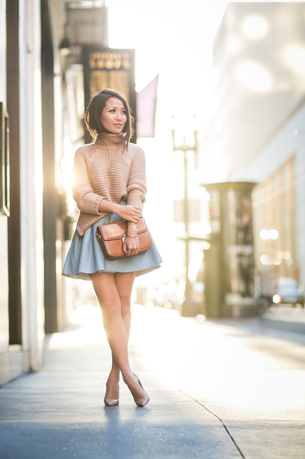 Wendy Nguyen is wearing a nude turtneck sweater from Mason by Michelle Mason, and a light blue circle skirt from H&M, shoes from Celine and the shoes are from Christian Louboutin