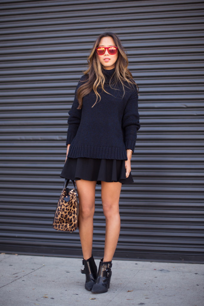 Sweater And Skirt: Aimee Song is wearing a dark blue turtleneck from A.L.C, and the skirt is from Robert Rodrigeuz