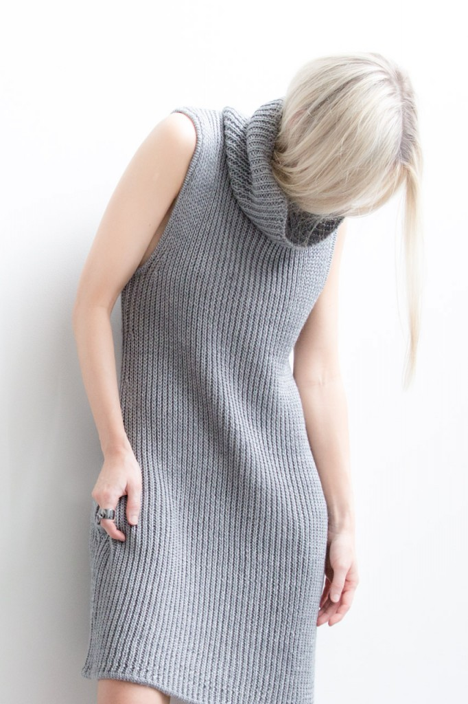 Figtny is wearing a wearing a vertical knit charcoal dress from Nasty Gal
