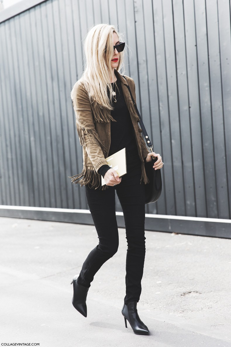 Sara Escudero is wearing a suede camel fringed jacket with black skinny jeans