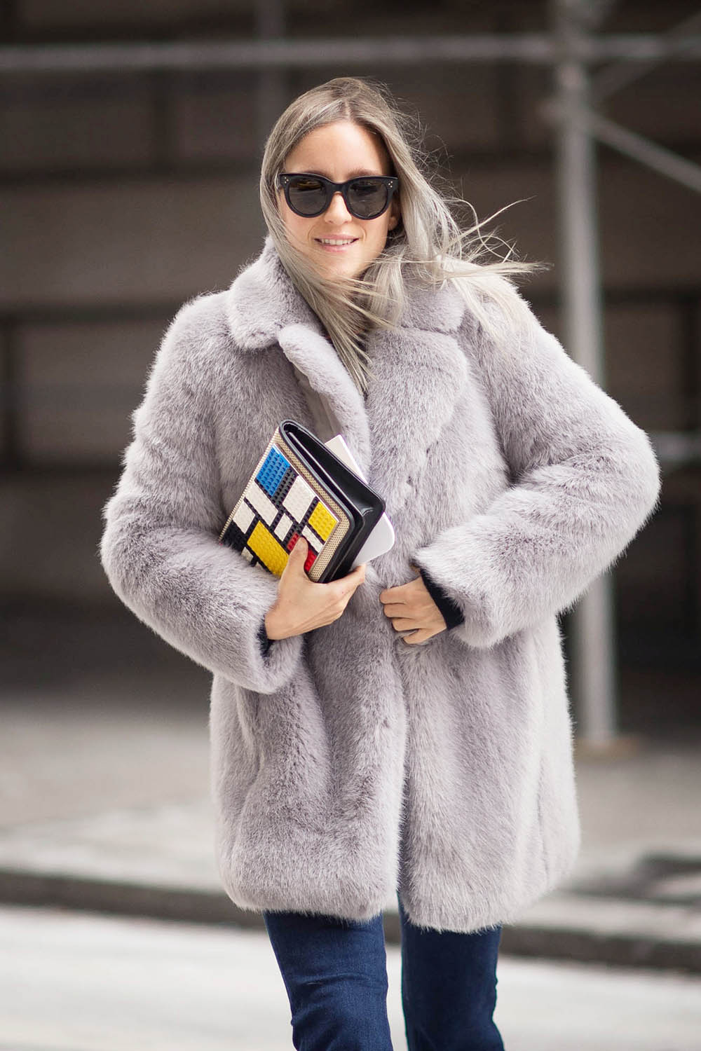 Charlotte Groeneveld is wearing a grey Whistles fluffy coat for winter
