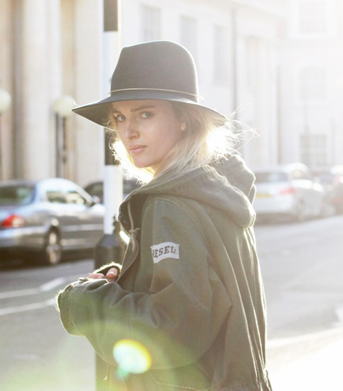 Mija is wearing an oversized military green parka from Diesel and the blue fedora is from Janessa Leone