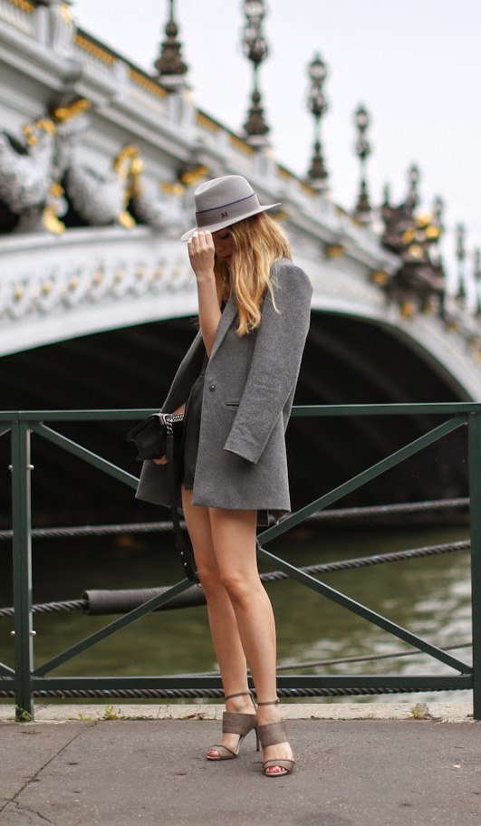 Caroline Louis is wearing a grey rabbit felt fedora from Maison Michel