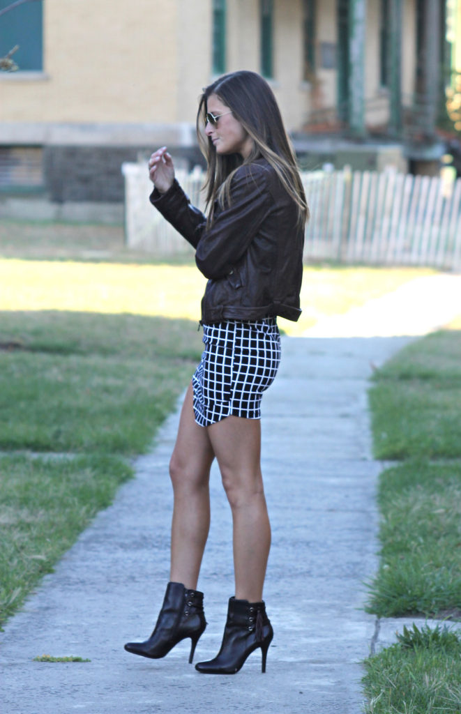 Tilden Brighton in her fitted asymmetrical grid print skirt from Madison Square